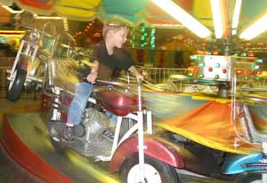Ben riding a carnival ride in 2007.